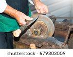 the knife sharpener old craft. | Shutterstock . vector #679303009