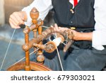 woman with chassis to put wool. | Shutterstock . vector #679303021