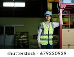 female warehouse worker with... | Shutterstock . vector #679330939