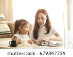 asian family teach asian cute... | Shutterstock . vector #679347739