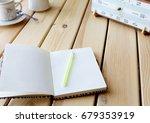 notebook  pen  watch on a light