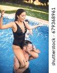 girl sitting on shoulders of... | Shutterstock . vector #679368961