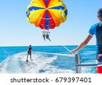 Happy couple parasailing in...