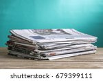 newspapers folded and stacked... | Shutterstock . vector #679399111