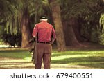 lonely senior walking at park ... | Shutterstock . vector #679400551