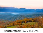 autumn landscape against blue... | Shutterstock . vector #679411291
