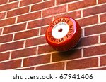 red fire alarm on brick wall | Shutterstock . vector #67941406