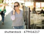 woman using phone | Shutterstock . vector #679416217