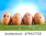 chicken eggs with emotion face | Shutterstock . vector #679417729