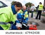 paramedics providing first aid... | Shutterstock . vector #67942438