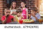 happy children are eating pizza ... | Shutterstock . vector #679426981