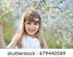 portrait of happy little girl... | Shutterstock . vector #679440589