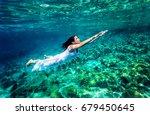 refreshing swimming underwater  ... | Shutterstock . vector #679450645