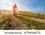 young cyclist riding mountain... | Shutterstock . vector #679456075