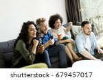 group of friends watching tv  ... | Shutterstock . vector #679457017