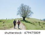 two men holding hands each... | Shutterstock . vector #679475809