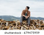 man in hat with ax sitting on... | Shutterstock . vector #679475959