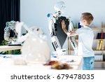 fair haired boy touching chest... | Shutterstock . vector #679478035