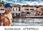 handsome man with tattoo... | Shutterstock . vector #679499611