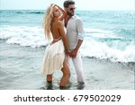 romantic couple on the beach | Shutterstock . vector #679502029