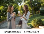 image of happy young two women... | Shutterstock . vector #679504375
