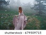 a woman in a dress is running...   Shutterstock . vector #679509715