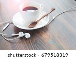 earphones and coffee cup on... | Shutterstock . vector #679518319