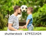 dad and son with soccer ball in ... | Shutterstock . vector #679521424