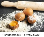eggs on flour next to wooden... | Shutterstock . vector #679525639
