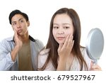 asian woman looking at her face ... | Shutterstock . vector #679527967