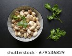 pistachio nuts in a bowl on... | Shutterstock . vector #679536829