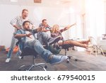 cheerful smiling colleagues... | Shutterstock . vector #679540015