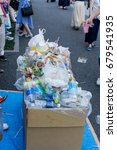 Small photo of TOKYO, Japan-MAY 31, 2017, The garbage waste from Sensoji temple festival over the capacity of bin.