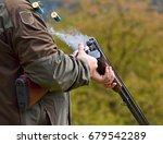 Gunman With Smoking Shotgun...