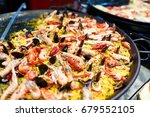 large skillet with paella ... | Shutterstock . vector #679552105