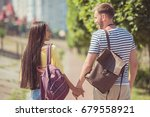 back view of young happy... | Shutterstock . vector #679558921