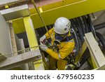 working at height. a commercial ... | Shutterstock . vector #679560235
