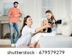 happy father looking at mother... | Shutterstock . vector #679579279