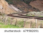 Curved Pair of Tracks in Mountains in British Columbia, Canada - stock photo