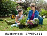 smiling mother and daughter... | Shutterstock . vector #679592611
