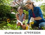 smiling mother teaching... | Shutterstock . vector #679593004