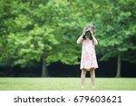Little Girl Holding A Single...