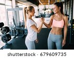 picture of two fitness women in ... | Shutterstock . vector #679609735