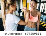 picture of two fitness women in ... | Shutterstock . vector #679609891