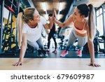 two attractive fitness girls... | Shutterstock . vector #679609987