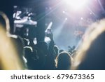 stage lights and crowd of... | Shutterstock . vector #679673365