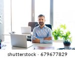 businessman at the desk with... | Shutterstock . vector #679677829