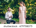 a young man stands on one knee... | Shutterstock . vector #679708375