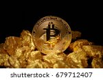 Small photo of Golden Bitcoin Coin and mound of gold. Bitcoin cryptocurrency. Business concept.