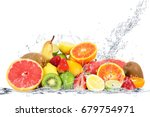 Small photo of fresh fruits falling in water